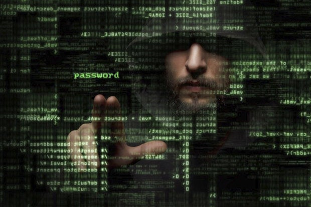 Hacker manipulating code