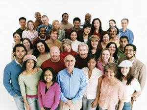 Elevated studio shot of a large mixed age, multiethnic crowd of men and women  dv1954038