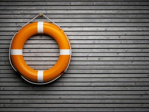 lifebuoy on wooden wall rescue overboard preserver saver