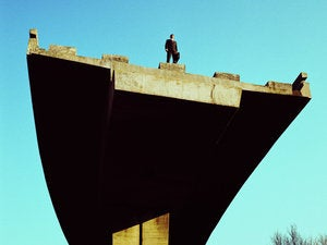 low angle view of a businessman standing atop an incomplete bridge stk33345bin