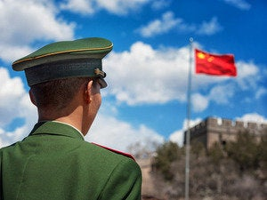 chinese soldier and flag