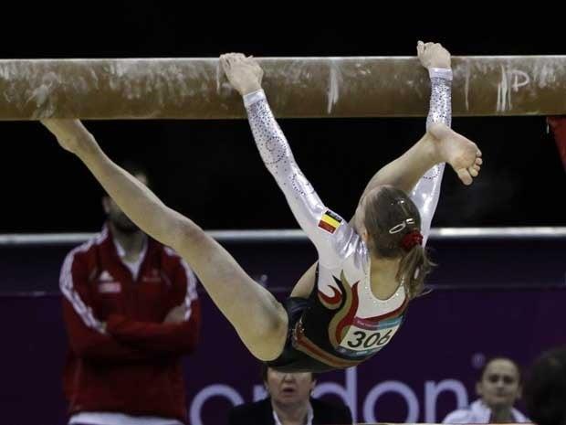 Gymmast falling off balance beam