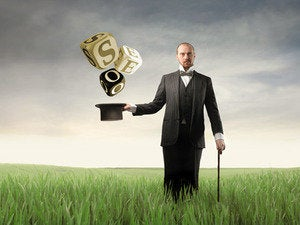 Magician standing in grassy field with SEO coming out of hat