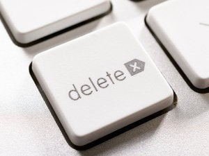 Closeup of delete button on white keyboard