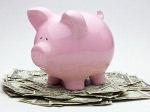 pigggybank one dollar bills