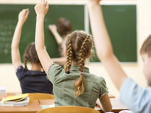 hands raised classroom kids