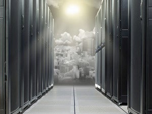 Network room and mainframes with virtual city in the cloud