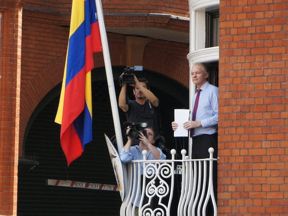 assange on balcony