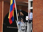 assange on balcony