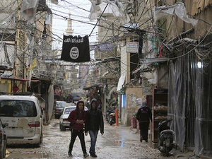 isis flag refugee camp