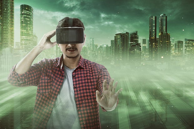 Young man with virtual reality head mask